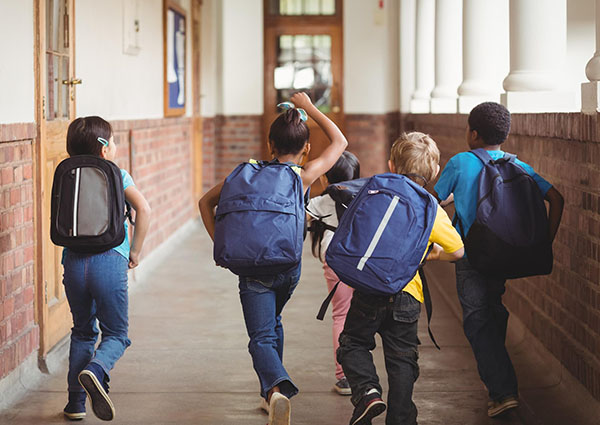 school of kids walking to class
